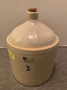 2 gallon Ruckels Stoneware jug Chipped on bottom