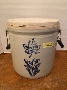 4 gallon Western Stoneware crock with wire bale and wood handles Small chip at rim and cracks on back Has wood top