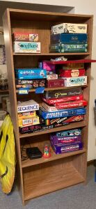 Modern five tier shelf, board games and a happy face helium balloon Shelf measures 30 x 11 x 72 and has four adjustable shelves