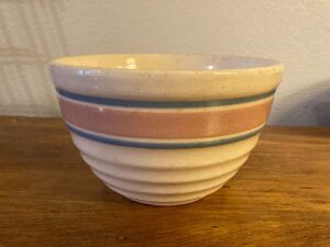 Unmarked 6 1/4 inch pink/blue ring ribbed stoneware mixing bowl