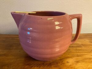 Unmarked pink glaze stoneware water pitcher