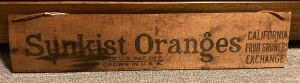 Sunkist Oranges fruit sign Measures 24 in. long - likely made from the side of an old fruit crate