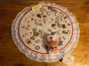 Embroidery hoop w Red Cross buttons and memorabilia