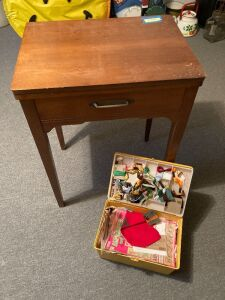 Sewing cabinet (no machine) measures 24 x 8 x 31 and a sewing box full of embroidery supplies