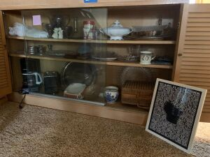 Contents of shelves includes Blue Delft, Jagermesiter ashtray, silver plate, mustache cup, glassware, two slice toaster, coffee pot and more
