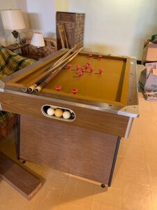 Foldable bumper pool table Measures 52 x 38 x 30  Felt is torn in one spot, see photos