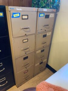 Four drawer letter file cabinet on the left Measures 25 x 28 x 52