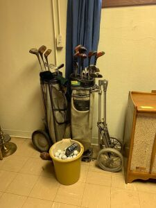Two sets of vintage golf clubs w pull carts and a pail of golf balls