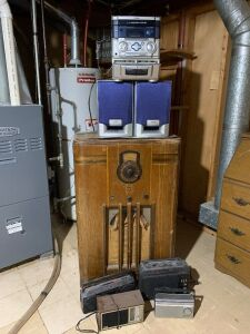 Music lot-Philco radio measures 24 x 12 x 40, AIWA AM/FM/dual cassette/CD and three other transistor radios  Top of Philco is warped