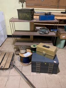 Four tier metal shelf, five drawer bin, empty tool box, ammo container, two wheels, and three spools of wire