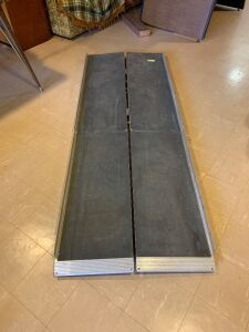 Foldable wheelchair ramp measures 30 x 84
