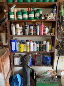Coffee cans full of misc. items-staples, drill bits, corks, string, nails, screws, shelf with spray paints, Coleman camp fuel, bag chair, Coleman camp stove and more. See all photos