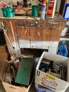 Workbench and three boxes in front of workbench and all items includes tire iron, Chicago Electric grinder, mineral spirits, Dirt Devil hand vac, wires and electrical items, box full of rope, multi meter and more. Work bench measures 36 x 23 538.