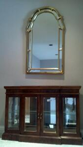small curio and wall mirror