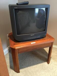 TV stand, TV, and end table