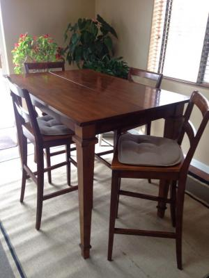 Bar stool height dining room table with 8 bar stool chairs and self contained leaf