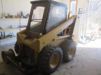 1996 Mustang 2060 skid loader, stick steer, good tires, manual detach for buckets, auxiliary hydraulics, 7 foot Wausau straight snow blade, 42-inch pallet Forks, 72 inch tooth bucket, open rops, 4000+ hours, diesel