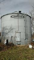 "24 ft Butler grain bin, 5-48"" rings High.  Bin in very good condition, drying floor, unloading auger, spreader at the top rust near the ladder on the inside of bin. Approximately 6000+ Bu capacity Bin with Heaters, Fan and  and drying floor.  Click for more details"