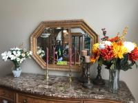 Wall mirror, candleholders, vases with artificial flowers