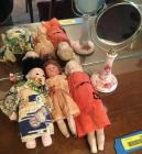 Three vintage dolls and a unique hand mirror Japanese doll Has head and arms detached