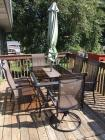 Hampton Bay patio table and 6 chairs with umbrella. Two chairs are swivel 41 x 65
