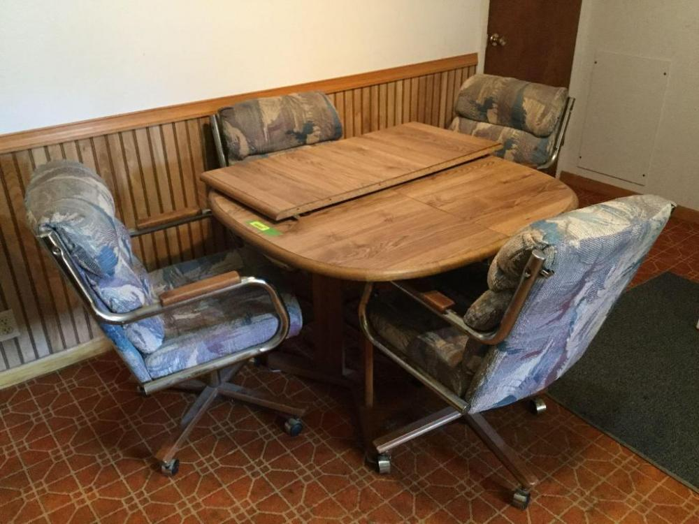 Dining Room Table And Four Upholstered Rolling Chairs 42 X 40 With