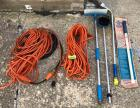 Three extension cords, car washing tools and holding tank clean out tool