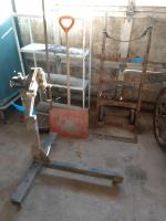 Engine stand, barrel freight cart, white shelving unit, snow shovel, push broom and small bench