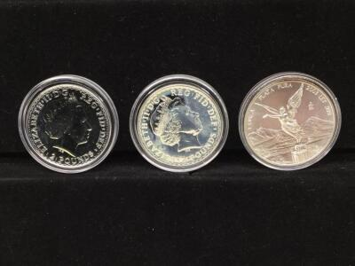 Three silver foreign coins