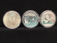 1986 Silver Eagle Coin and two foreign coins
